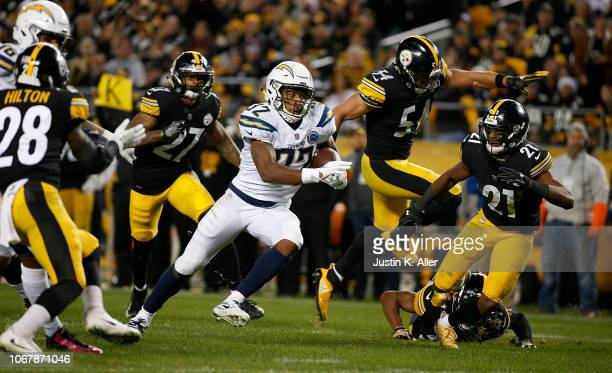 Justin Jackson of the Los Angeles Chargers rushes for a 18 yard touchdown in the fourth quarter during the game against the Pittsburgh Steelers at...