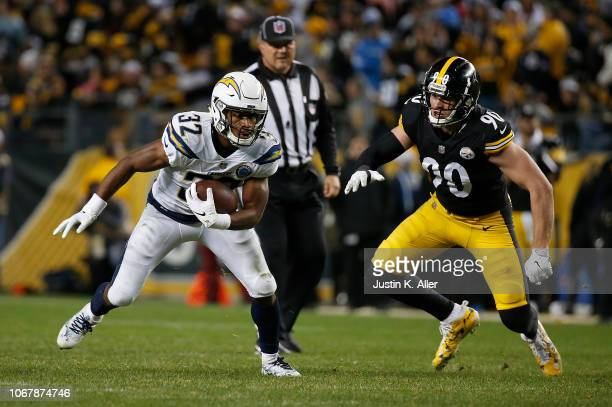 Justin Jackson of the Los Angeles Chargers rushes the ball against TJ Watt of the Pittsburgh Steelers in the second half during the game at Heinz...