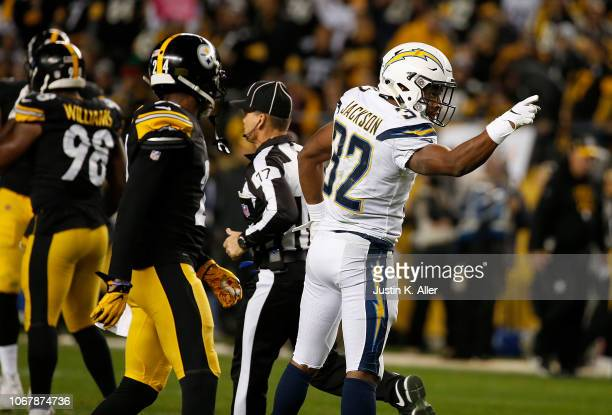 Justin Jackson of the Los Angeles Chargers signals a first down in the second half during the game against the Pittsburgh Steelers at Heinz Field on...