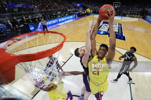 Justin Jackson of the Maryland Terrapins dunks the ball against Sean O'Mara of the Xavier Musketeers in the first half during the first round of the...