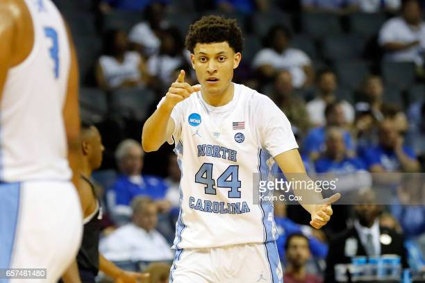 Justin Jackson of the North Carolina Tar Heels celebrates with teammates after a play in the first half against the Butler Bulldogs during the 2017...