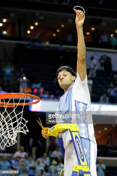 Justin Jackson of the North Carolina Tar Heels cuts down the net after defeating the Kentucky Wildcats during the 2017 NCAA Men's Basketball...