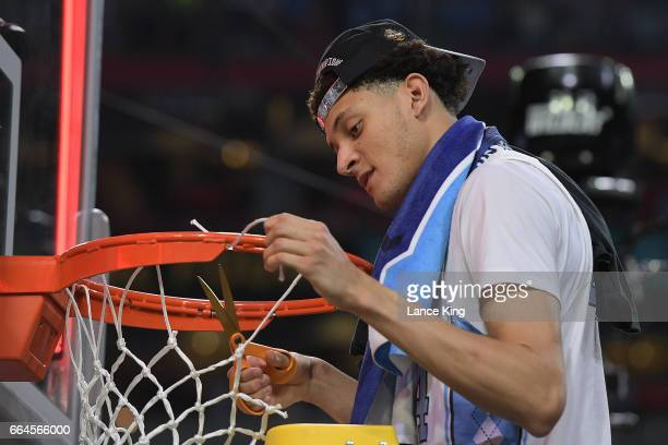 Justin Jackson of the North Carolina Tar Heels cuts the net following their 7165 victory against the Gonzaga Bulldogs during the 2017 NCAA Men's...