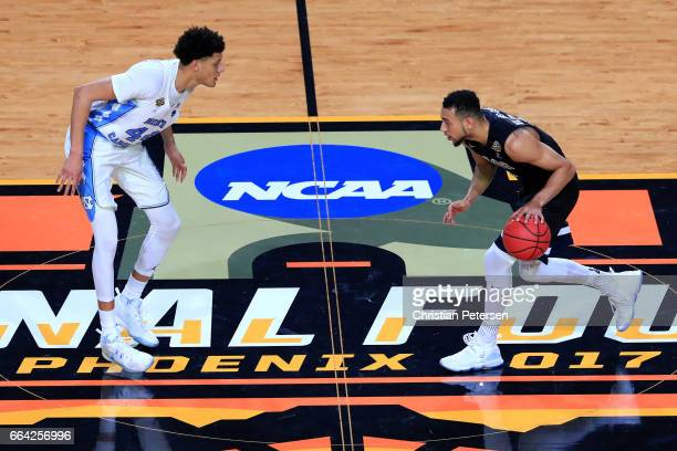 Justin Jackson of the North Carolina Tar Heels defends Nigel WilliamsGoss of the Gonzaga Bulldogs in the first half during the 2017 NCAA Men's Final...