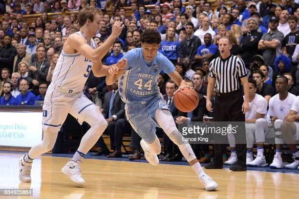 Justin Jackson of the North Carolina Tar Heels drives against Luke Kennard of the Duke Blue Devils at Cameron Indoor Stadium on February 9 2017 in...