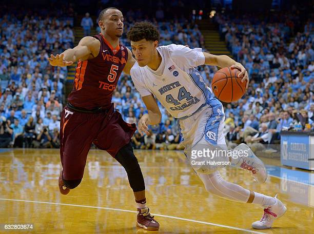 Justin Jackson of the North Carolina Tar Heels drives baseline against Justin Robinson of the Virginia Tech Hokies during the game at the Dean Smith...
