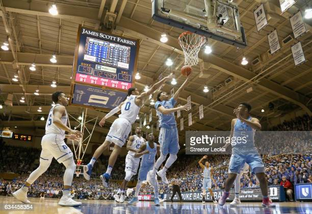 Justin Jackson of the North Carolina Tar Heels drives to the basket against Jayson Tatum of the Duke Blue Devils during their game at Cameron Indoor...