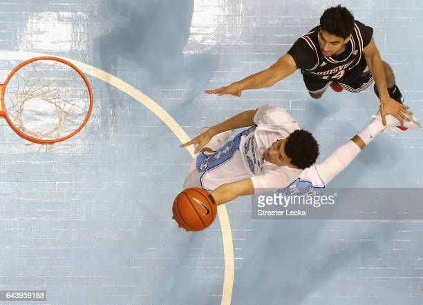 Justin Jackson of the North Carolina Tar Heels drives to the basket agianst Anas Mahmoud of the Louisville Cardinals during their game at the Dean...