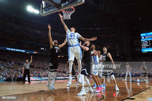 Justin Jackson of the North Carolina Tar Heels drives to the basket against Nigel WilliamsGoss of the Gonzaga Bulldogs in the second half during the...