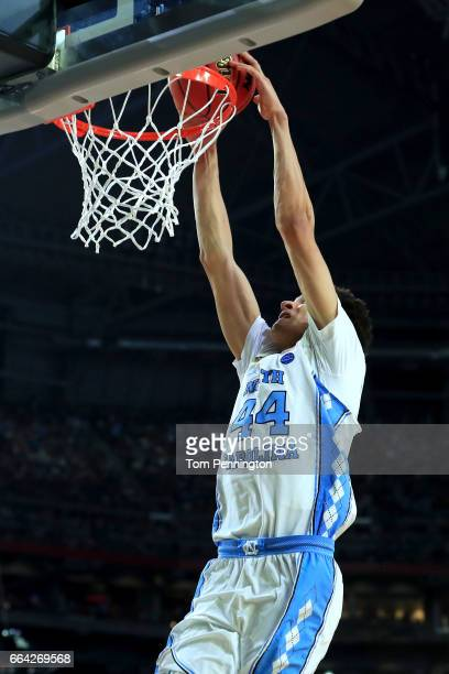 Justin Jackson of the North Carolina Tar Heels dunks late in the second half against the Gonzaga Bulldogs during the 2017 NCAA Men's Final Four...