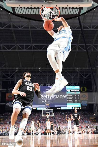 Justin Jackson of the North Carolina Tar Heels dunks late in the second half against Josh Perkins of the Gonzaga Bulldogs during the 2017 NCAA Men's...