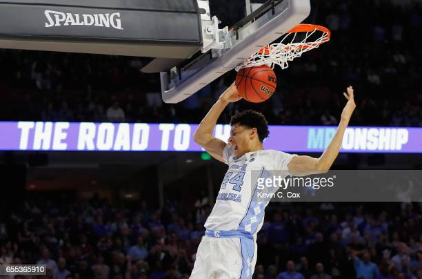 Justin Jackson of the North Carolina Tar Heels dunks the ball at the end of the second half against the Arkansas Razorbacks during the second round...