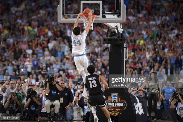 Justin Jackson of the North Carolina Tar Heels dunks the ball to increase their lead to 7065 with 12 seconds remaining in the game against the...