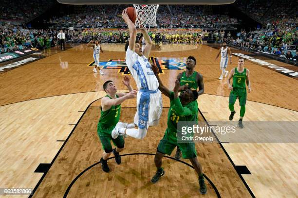 Justin Jackson of the North Carolina Tar Heels goes in for a dunk during the 2017 NCAA Men's Final Four Semifinal against the Oregon Ducks at...