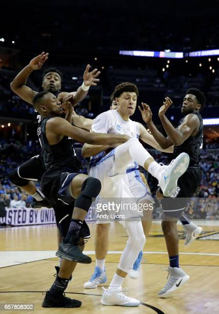 Justin Jackson of the North Carolina Tar Heels grabs a rebound against Kelan Martin Avery Woodson and Kamar Baldwin of the Butler Bulldogs in the...