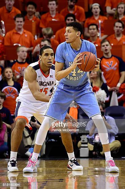Justin Jackson of the North Carolina Tar Heels handles the ball against Malcolm Brogdon of the Virginia Cavaliers in the second half during their...