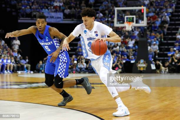 Justin Jackson of the North Carolina Tar Heels handles the ball against Malik Monk of the Kentucky Wildcats in the second half during the 2017 NCAA...