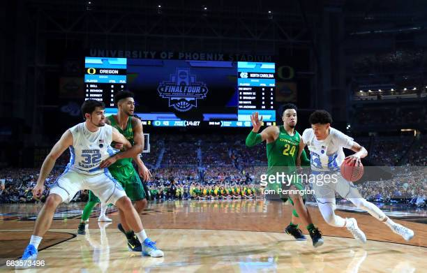 Justin Jackson of the North Carolina Tar Heels handles the ball against Dillon Brooks of the Oregon Ducks in the second half during the 2017 NCAA...