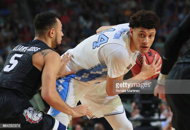 Justin Jackson of the North Carolina Tar Heels handles the ball against Nigel WilliamsGoss of the Gonzaga Bulldogs in the first half during the 2017...