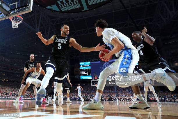 Justin Jackson of the North Carolina Tar Heels handles the ball against Nigel WilliamsGoss of the Gonzaga Bulldogs in the second half during the 2017...