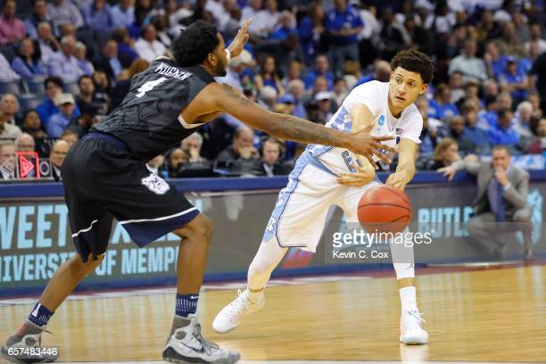 Justin Jackson of the North Carolina Tar Heels looks to pass against Tyler Wideman of the Butler Bulldogs in the second half during the 2017 NCAA...