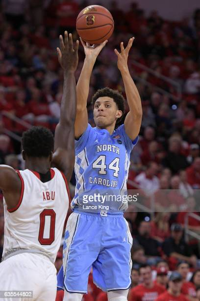 Justin Jackson of the North Carolina Tar Heels puts up a shot against AbdulMalik Abu of the North Carolina State Wolfpack at PNC Arena on February 15...