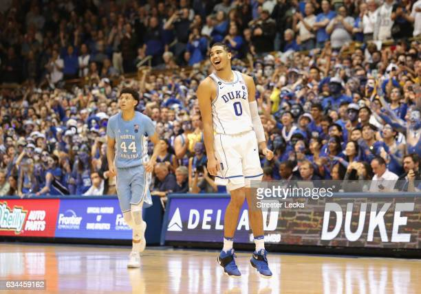 Justin Jackson of the North Carolina Tar Heels watches as Jayson Tatum of the Duke Blue Devils celebrates after defeating the Tar Heels 8678 in their...