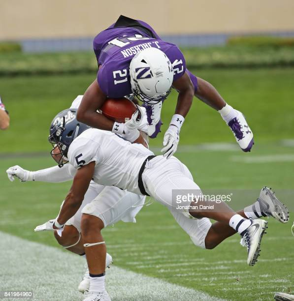 Justin Jackson of the Northwestern Wildcats flips in the air after being hit by Dameon Baber of the Nevada Wolf Pack at Ryan Field on September 2,...