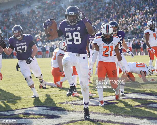 Justin Jackson of the Northwestern Wildcats scores a touchdown against the Illinois Fighting Illini during the second half on November 29, 2014 at...