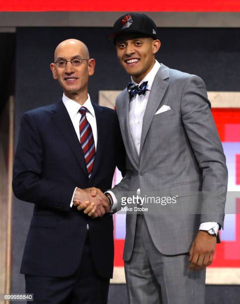 Justin Jackson walks on stage with NBA commissioner Adam Silver after being drafted 15th overall by the Portland Trail Blazers during the first round...