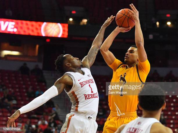 Justin James of the Wyoming Cowboys shoots against Kris Clyburn of the UNLV Rebels during their game at the Thomas Mack Center on January 05 2019 in...