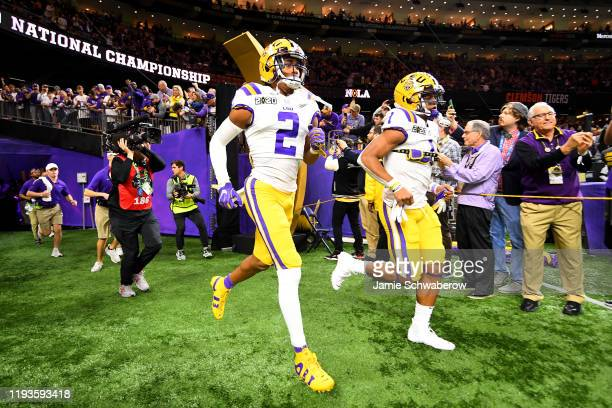 Justin Jefferson and Ja'Marr Chase of the LSU Tigers take the field against the Clemson Tigers during the College Football Playoff National...