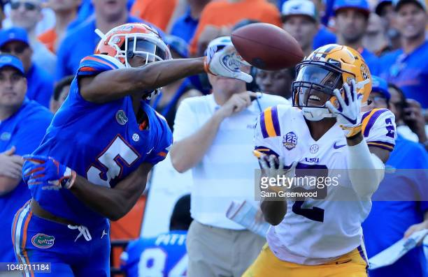 Justin Jefferson attempts a reception against CJ Henderson of the Florida Gators during the game at Ben Hill Griffin Stadium on October 6 2018 in...