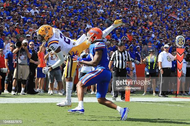 Justin Jefferson of the LSU Tigers attempts a reception while being defended by CJ Henderson of the Florida Gators during the game at Ben Hill...