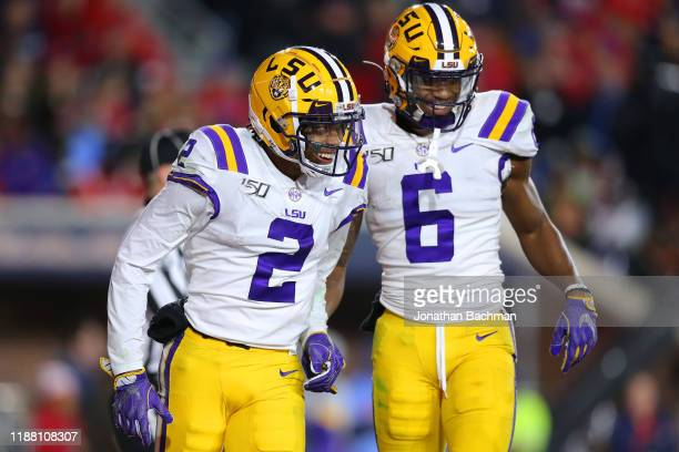 Justin Jefferson of the LSU Tigers celebrates a touchdown with Terrace Marshall Jr #6 during the second half of a game against the Mississippi Rebels...