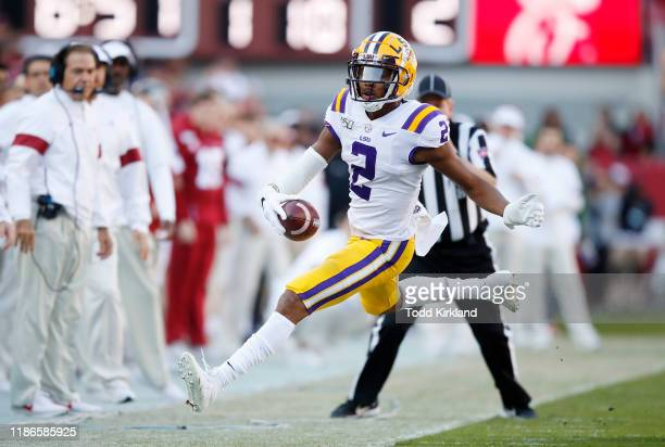 Justin Jefferson of the LSU Tigers goes out of bounds during the first half against the Alabama Crimson Tide in the game at BryantDenny Stadium on...