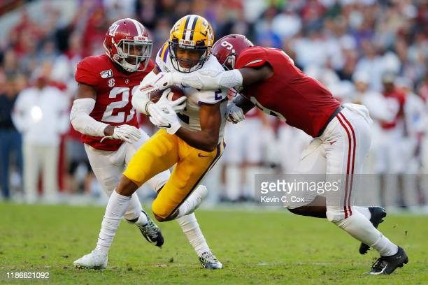 Justin Jefferson of the LSU Tigers is tackled by Jordan Battle of the Alabama Crimson Tide during the first half in the game at BryantDenny Stadium...