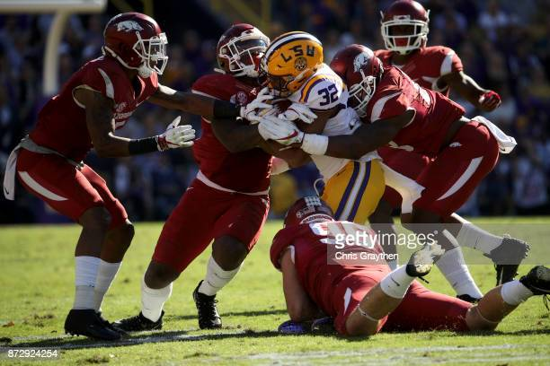 Justin Jefferson of the LSU Tigers is tackled by Karl Roesler of the Arkansas Razorbacks at Tiger Stadium on November 11 2017 in Baton Rouge Louisiana