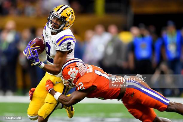 Justin Jefferson of the LSU Tigers is tackled by K'Von Wallace of the Clemson Tigers after a 7yard pass from Joe Burrow during the fourth quarter of...