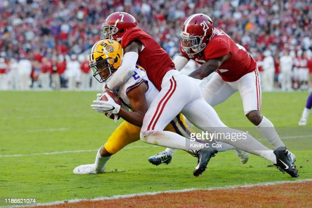 Justin Jefferson of the LSU Tigers is tackled by Trevon Diggs of the Alabama Crimson Tide short of the goal line during the first half in the game at...
