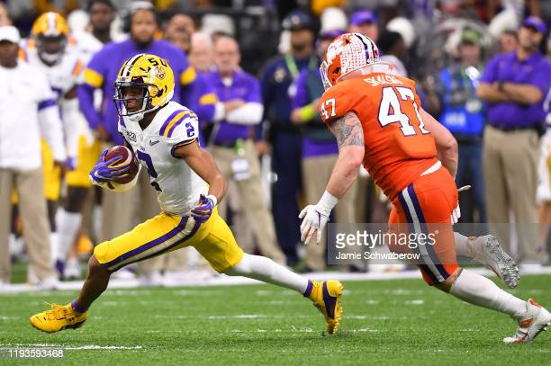 Justin Jefferson of the LSU Tigers makes a reception against James Skalski of the Clemson Tigers during the College Football Playoff National...