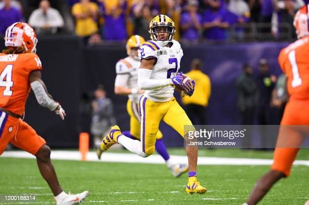 Justin Jefferson of the LSU Tigers picks up a big gain against the Clemson Tigers during the College Football Playoff National Championship held at...