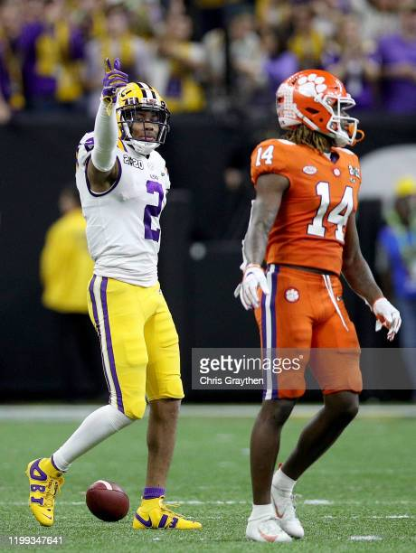 Justin Jefferson of the LSU Tigers reacts to a play against Denzel Johnson of the Clemson Tigers in the College Football Playoff National...