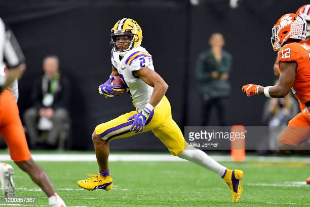 Justin Jefferson of the LSU Tigers runs with the ball after a 22yard pass from Joe Burrow during the second quarter of the College Football Playoff...