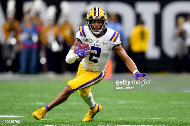 Justin Jefferson of the LSU Tigers runs with the ball after a 56yard pass from Joe Burrow during the second quarter of the College Football Playoff...