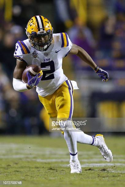 Justin Jefferson of the LSU Tigers runs with the ball during a game against the Rice Owls at Tiger Stadium on November 17 2018 in Baton Rouge...