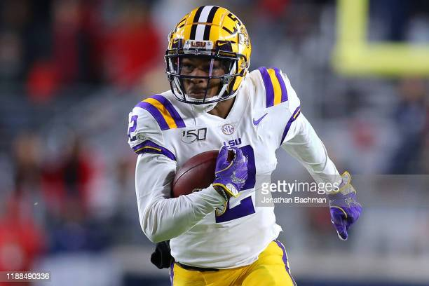 Justin Jefferson of the LSU Tigers runs with the ball during a game against the Mississippi Rebels at VaughtHemingway Stadium on November 16 2019 in...