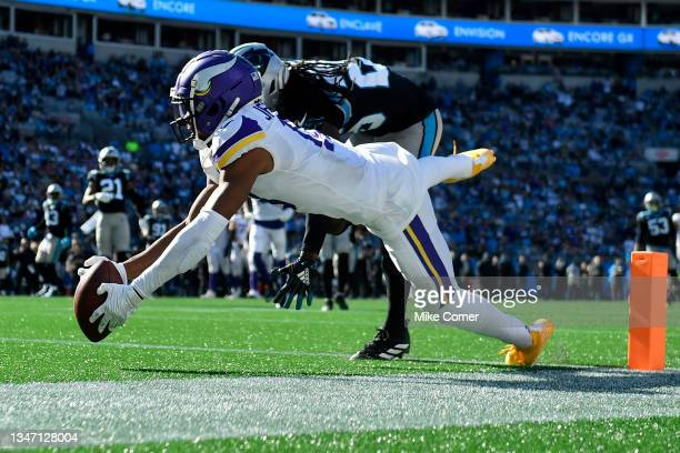 Justin Jefferson of the Minnesota Vikings attempts the catch during the fourth quarter against the Carolina Panthers at Bank of America Stadium on...
