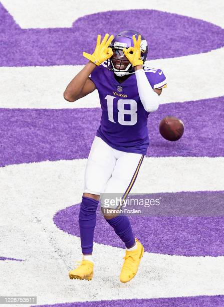 Justin Jefferson of the Minnesota Vikings celebrates a touchdown against the Tennessee Titans during the third quarter of the game at U.S. Bank...