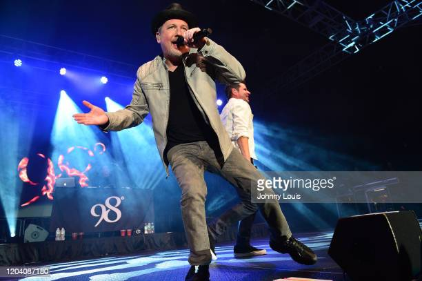 Justin Jeffre and Nick Lachey andof 98 Degrees perform on stage at Seminole Casino Coconut Creek on February 28, 2020 in Coconut Creek, Florida.